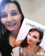 Karen holding her book, Lymphedema: Sentenced to Life in Bed, but I Escaped.